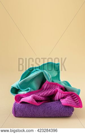 Multicolored Microfiber Cloths For Washing On A Neutral Beige Background, Cleaning Concept