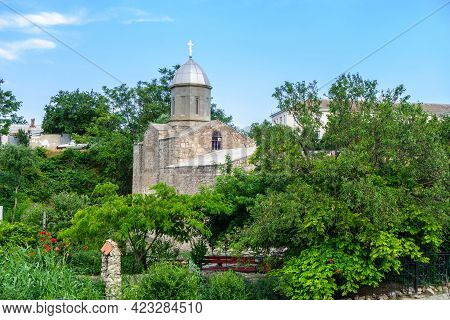 Orthodox Church Of John The Baptist Surrounded By Lush Blooming Garden, Feodosia, Crimea. Temple Was