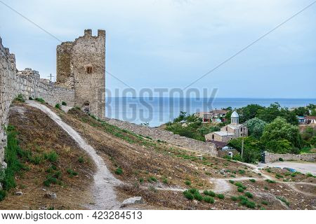 Inside Of Genoese Fortress In Feodosia, Crimea. Medieval Walls & Tower Are On Foreground. Church Of
