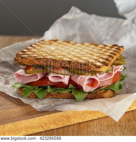 Delicious Sandwich, With Arugula, Tomatoes And Cucumbers. Fresh Ham Thin Slices. A Quick Snack. Sele