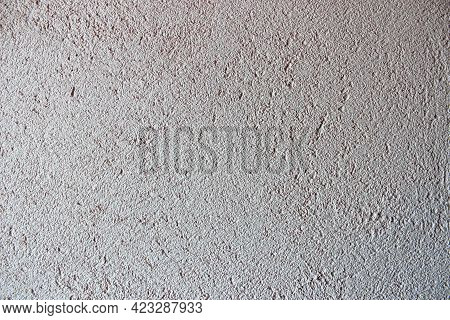 Textured Background Of Filler Paste Applied With Putty Knife In Irregular Dashes And Strokes