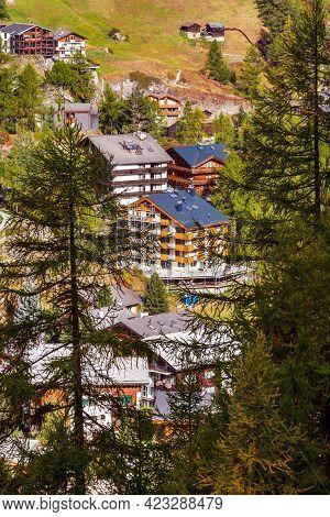 Beautiful Alpine Village In The Pine Woods, Switzerland, Swiss Alps Near Zermatt And Cable Car Cabin
