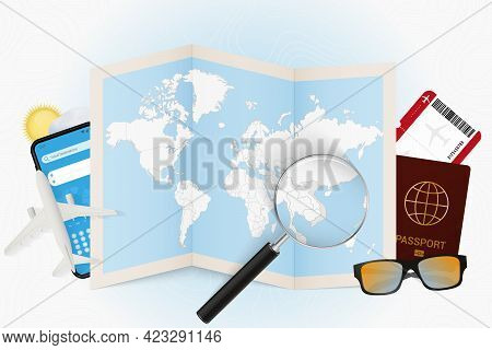 Travel Destination Vietnam, Tourism Mockup With Travel Equipment And World Map With Magnifying Glass