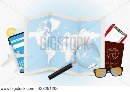 Travel Destination Indonesia, Tourism Mockup With Travel Equipment And World Map With Magnifying Gla