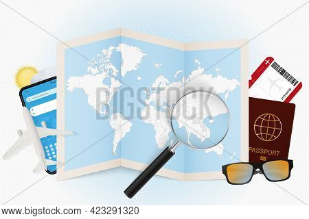 Travel Destination Laos, Tourism Mockup With Travel Equipment And World Map With Magnifying Glass On