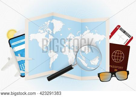 Travel Destination Malaysia, Tourism Mockup With Travel Equipment And World Map With Magnifying Glas