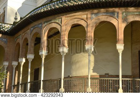 Arches Of Mudejar Architecture Pavilion In Park Of Seville, Andalusia, Spain.