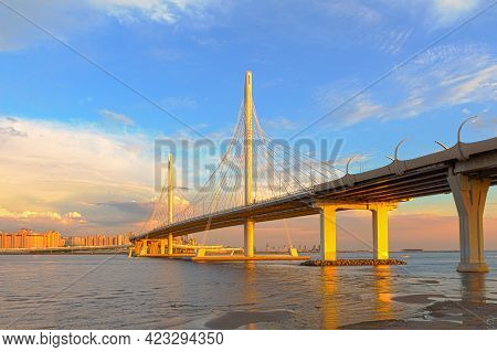 Cable-stayed Bridge In The Light Of The Setting Sun Across The Neva River On The Western Rapid Diame