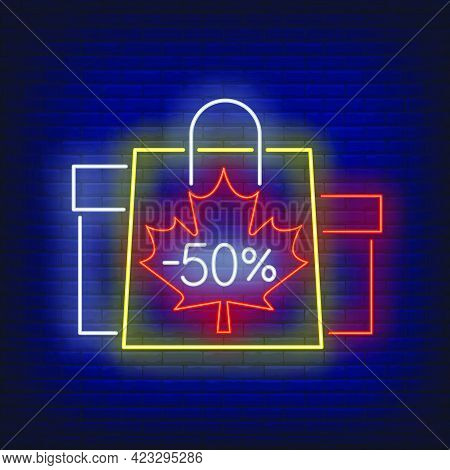 Minus Fifty Percent Neon Lettering With Shopping Bags And Boxes. Discount, Sale Design. Night Bright