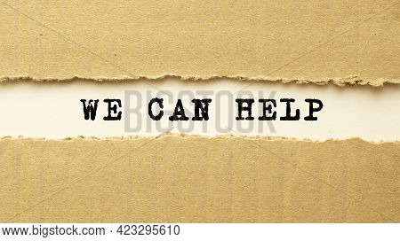 Text We Can Help Appearing Behind Torn Brown Paper.