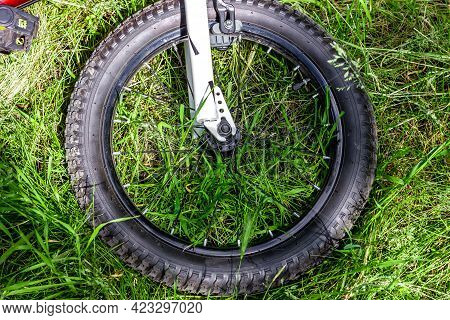 Bicycle Wheel On The Grass. Part Of The Bike. Spoked Rim.
