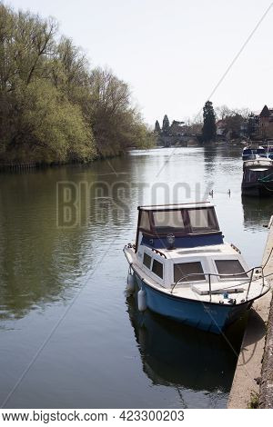 A Small Boat Moored Along The Thames River In Maidenhead In The Uk, Taken On The 30th March 2021
