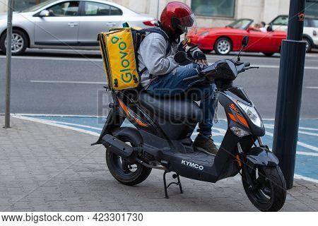 Poland, Warsaw - Jun 05, 2021: Glovo\'s Food Supplier On A Motorcycle. Glovo Servce