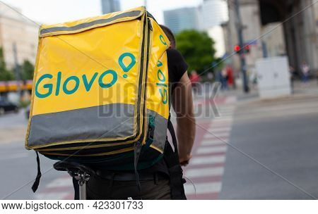 Poland, Warsaw - Jun 05, 2021: Glovo Cyclist On The Street In The City Center. Food Delivery. Close
