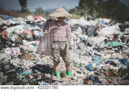 Poor Children Stand On Garbage,  Human Trafficking, Child Labor.