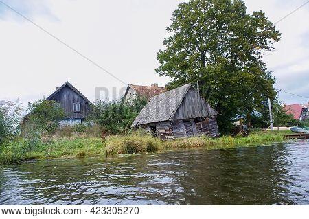 Matrosovka River, Polessky District, Kaliningrad Region, Russia, September 21, 2019. Wooden Houses O