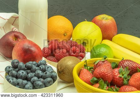 Fruits Are Laid Out On The Fruit Milkshake Table. Fruit Cocktail With Berries On A Wooden Table. Bac