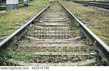 Perspective View Of Railroad Track With Wooden Railroad Ties