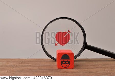 Magnifying Glass With Love And Scammer Icons