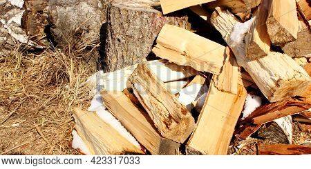 Abstract Photograph Of Piles Of Natural Wooden Logs. Background. Harvesting Firewood For The Winter.