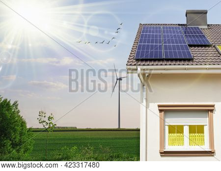 Solar Panels On The Roof Of A Modern House. Alternative Energy Source.