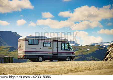 Camper Car On Roadside In Norwegian Mountains. Traveling, Holidays And Adventure Concept. Norway Sca