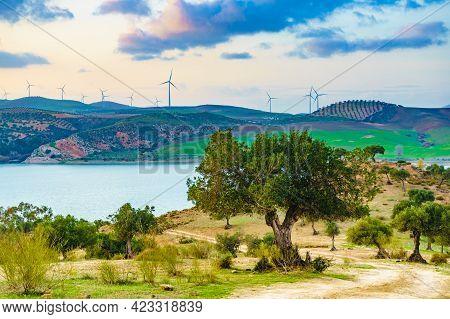 Andalucia Landscape With Wind Turbines On Hills. Lake Embalse Del Guadalhorce, Ardales Reservoir, Pr