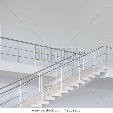 Empty modern office stairs with handrail