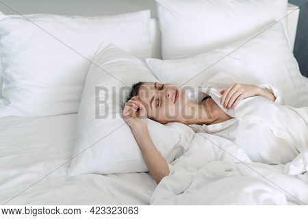 Concept Of Recreation And Healthy Sleep On Orthopedic Mattress. Top View Of Young Woman Dressed In N