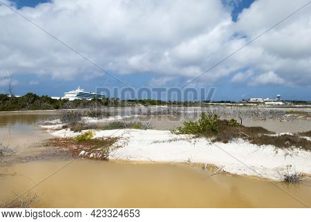 The View Of Brown Color Lagoon And A Cruise Ship In A Background On Grand Turk Island (turks And Cai