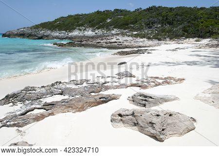 The View Of An Empty Beach With Rocks On Uninhabited Half Moon Cay Island (bahamas).