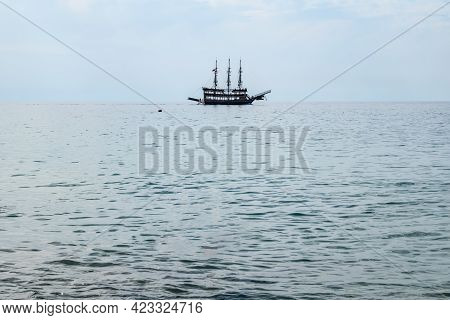 Silhouette Of A Three-masted Vintage Ship On The Sea Horizon. Beautiful Seascape With Copy Space