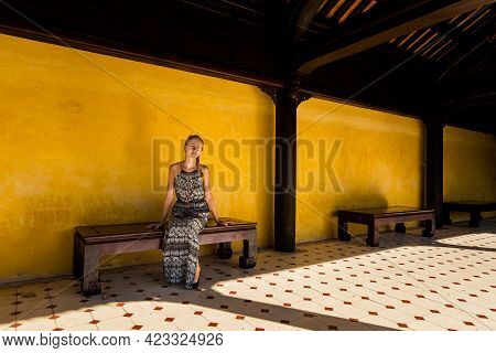 Young Caucasian Pretty Woman In Beautiful Architecture Photo Of Imperial City - Citadel Hue, Vietnam