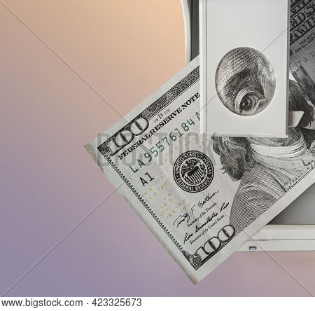 Checking Money For Authenticity. Benjamin Franklin On The 100 Dollar Bill Looks Into The Frame Throu