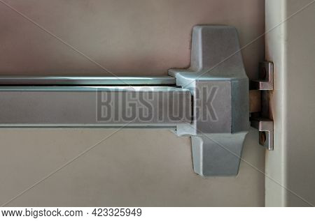Close-up Of Latch And Door Handle Of Emergency Exit. Push Bar And Rail For Panic Exit. Open One Way