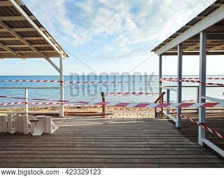 Beach Bar Closed With Warning Tape Due To Reconstruction Or Restrictions For Coronavirus Pandemic