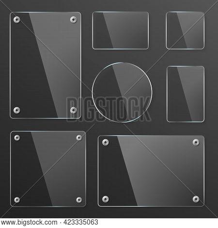 Transparent Glass Plates Set With Mounts On Dark Background