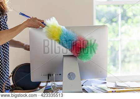 A Woman Holding Colorful, Non Scratch Plush Microfiber Duster Brush Is Removing The Dust From The Ba