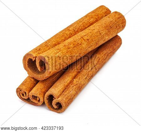 Several Cinnamon Sticks Insolated On White Background