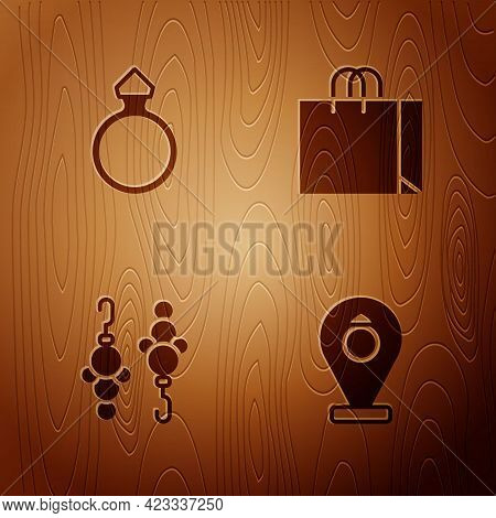 Set Jewelry Store, Diamond Engagement Ring, Earrings And Shopping Bag Jewelry On Wooden Background.
