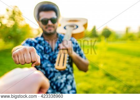 Handsome Indian Man Lerning To Playing Guitar In Summer Park