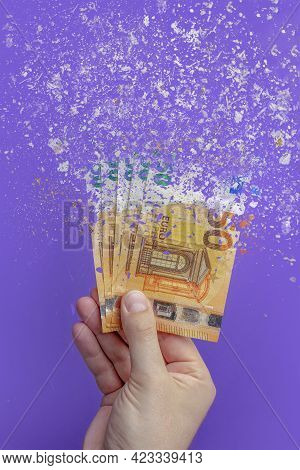 Spending Money, Spending All Money Is Illiterate. The Euro Banknote Turns To Ash, Dissolves Against
