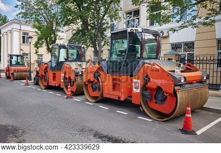 Row Of Heavy Vibratory Rollers In The City Street Ready For Asphalt Paving, Construction And Repair