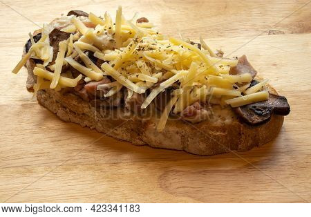 Overview Of A Slice Of Ham, Mushroom And Cheese, Tar-tine Isolated On A Plain Background