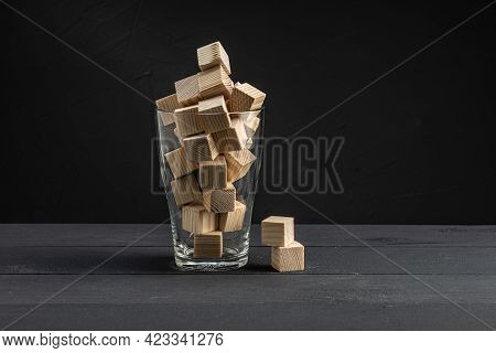 A Full Glass Of Wooden Cubes Two Cubes Are Next To The Glass They Are Not Included. Beautiful Backgr