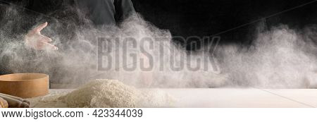 Hand Of Professional Cook Sprinkles Flour, Flour Flies In The Form Of A Cloud