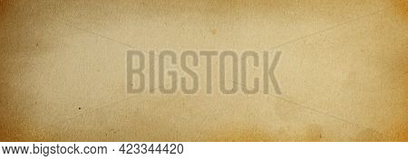Old Blank Grunge Background Of Brown Paper With Vignette