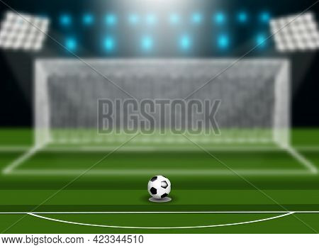 Soccer Ball On Green Field In Front Of Goal Post.