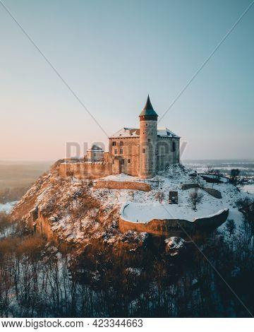 Kunetice Mountain Castle, State Castle Kuneticka Hora, Raby, Czech Republic. Winter Aerial Photograp