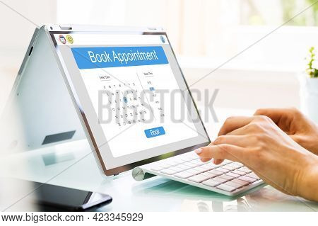 Booking Meeting Calendar Appointment On Laptop Online